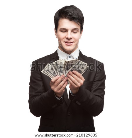 young funny caucasian businessman in black suit holding money isolated on white - stock photo