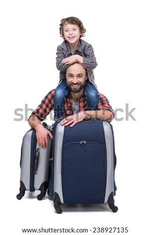 Young funny father and son with luggage, isolated on white background. - stock photo