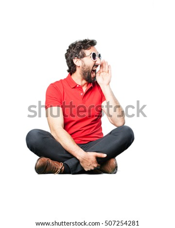 young funny man shouting sitting down.