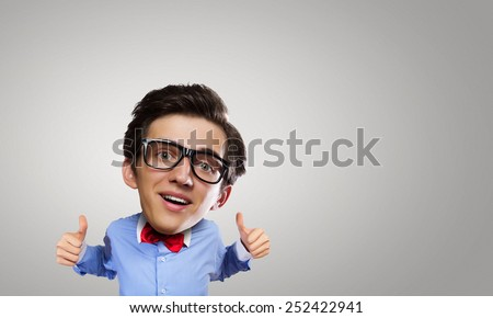 Young funny man with big head showing thumbs up
