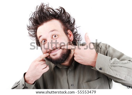 Young funny man with silly face and crazy hair - stock photo