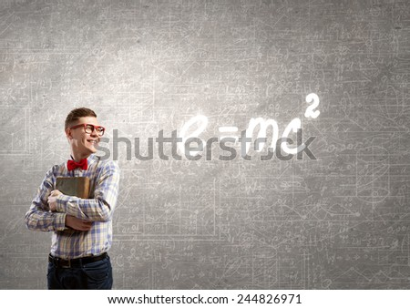 Young funny science man in red glasses