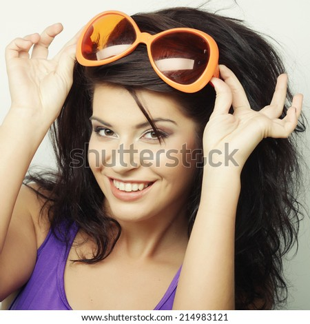 young funny woman with big orange sunglasses - stock photo