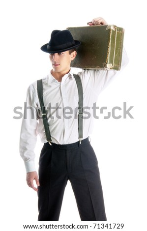 young gangster man holding an old suitcase on white background - stock photo