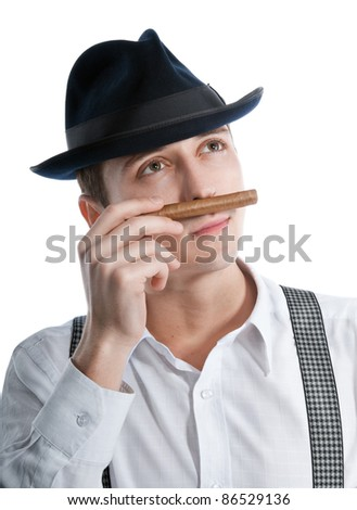 young gangster man sniffing a cigar. isolated on white background