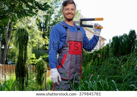 Young gardener with cutting clippers  - stock photo