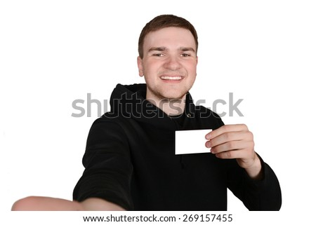 Young gay guy makes self with a blank card in his hand. A successful man shows his card - stock photo