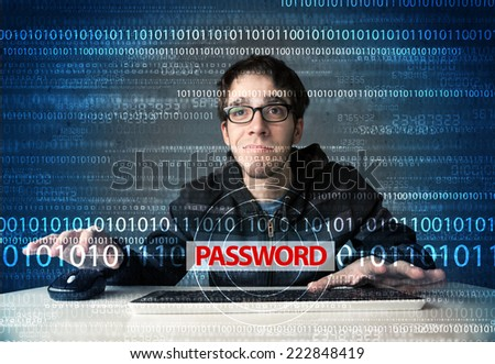 Young geek hacker stealing password on futuristic background - stock photo