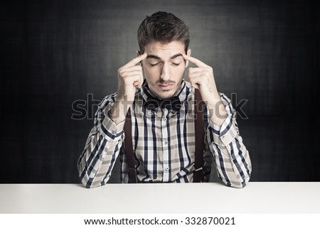 young genius concentrated - stock photo