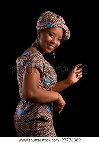 Young Ghanese african woman showing a dance in her traditional national costume - stock photo