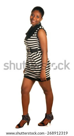 Young ghanese girl posing against a white background - stock photo