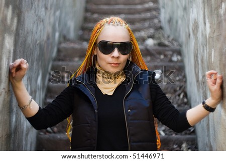 Young ginger caucasian girl with red dreadlocks - stock photo