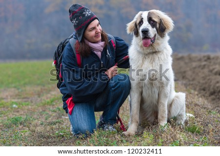 Young girl affection moment with her Bucovina shepherd dog