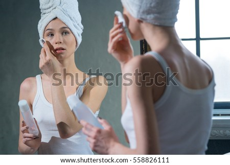 Young girl after shower rubbing face