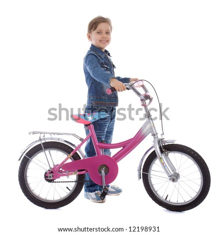 Young girl ages 5-7 years old isolated on white stay with her bike - stock photo