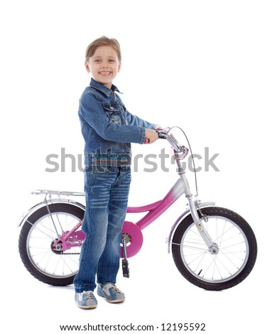 Young girl ages 5-7 years old isolated on white stay with her new bike - stock photo