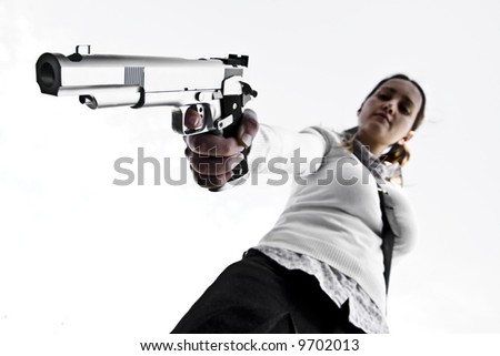 Young girl aiming with a gun isolated on white - stock photo