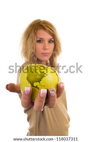 Young girl an earth globe in hand - stock photo