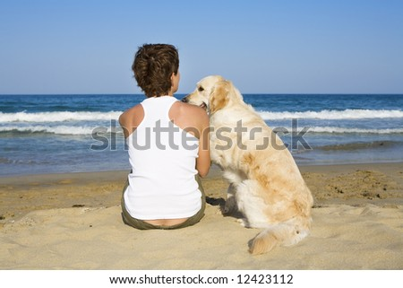 Young girl and a dog sitting together