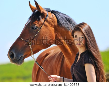 Young  girl  and  bay horse - stock photo