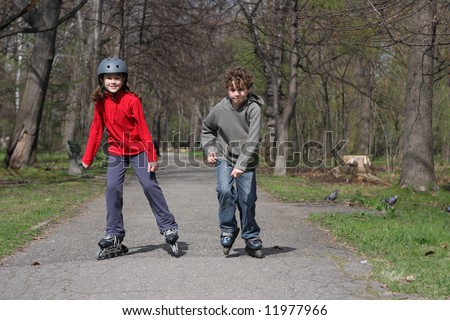 Young girl and boy on roller blades