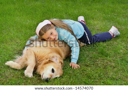 Young girl and dog -  golden retriever - stock photo