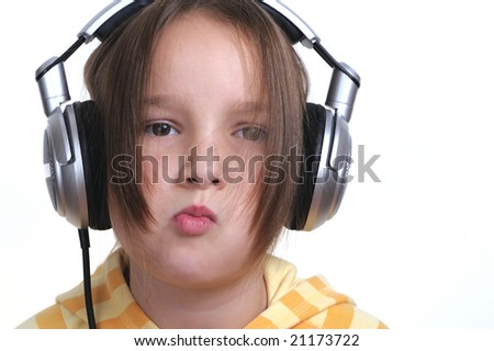 Young girl and headphones - stock photo