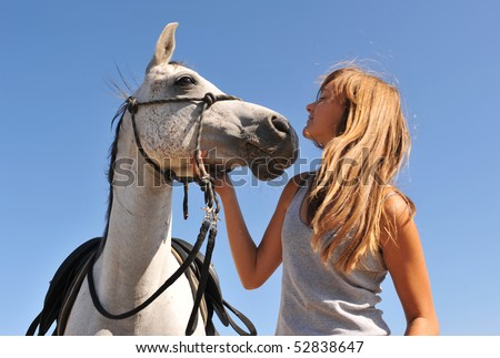 young girl and her best friend arabian horse - stock photo
