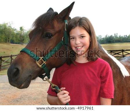 Young girl and horse - stock photo