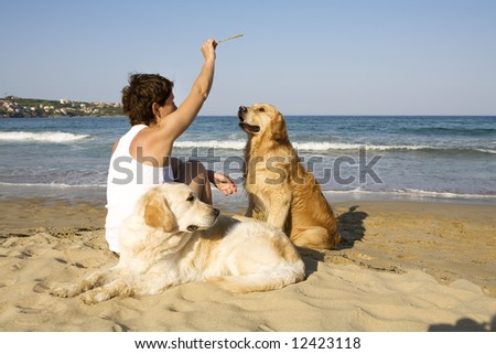 Young girl and sitting with her dogs