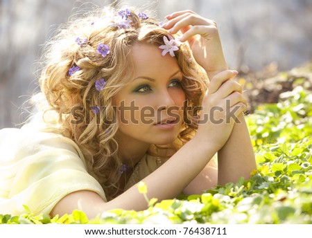 Young girl and spring flowers in her hair - stock photo