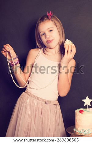 Young girl and sweet cupcake - stock photo