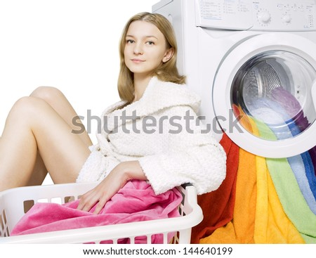 young girl and washing machine with colorful things to wash, isolated