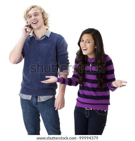 Young girl angry at her boyfriend on his cell phone - stock photo