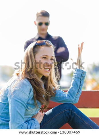 Young girl angry her boyfriend because he's infidelity - stock photo