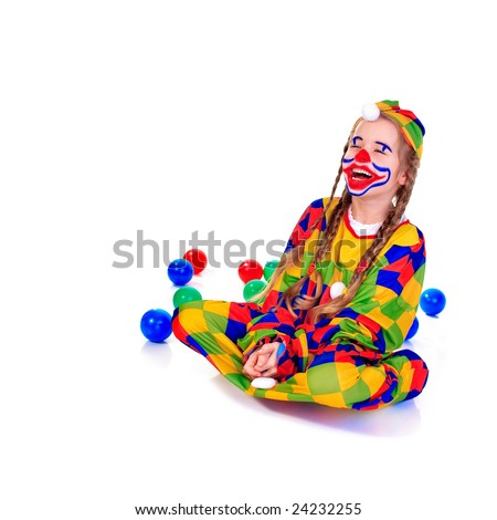 Young girl as jester on white background