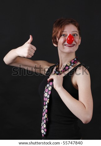 Young girl as mime with red nose - stock photo