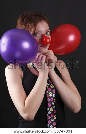 Young girl as mime with red nose and twoo baloons - stock photo