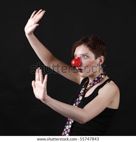 Young girl as mine with cravat and red nose - stock photo