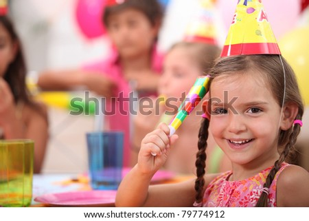 Young girl at a birthday party - stock photo