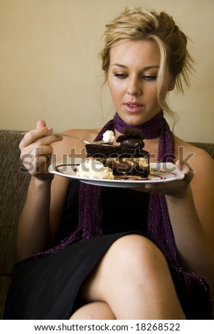 young girl at a cafe eating cake - stock photo