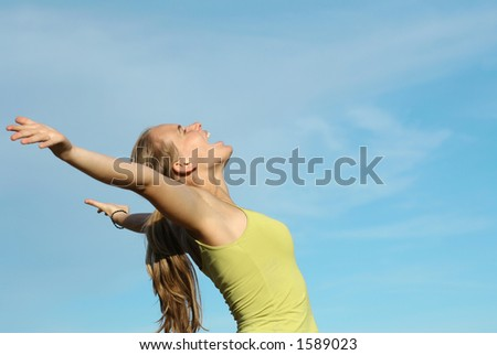 young girl at one with the world - stock photo