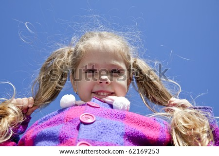 Young girl at outdoor. - stock photo