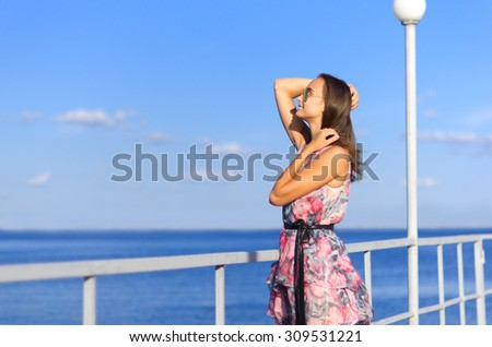 Young girl at pier (normal version)