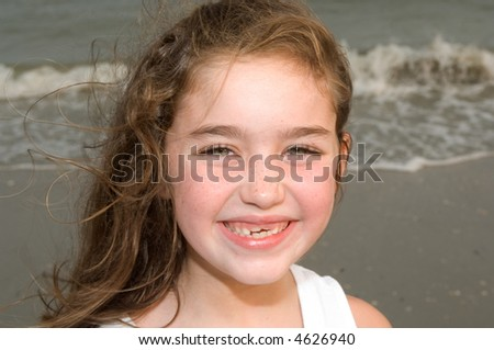 Young Girl at the Beach Smiling