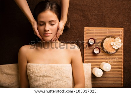 Young girl at the beautician - stock photo