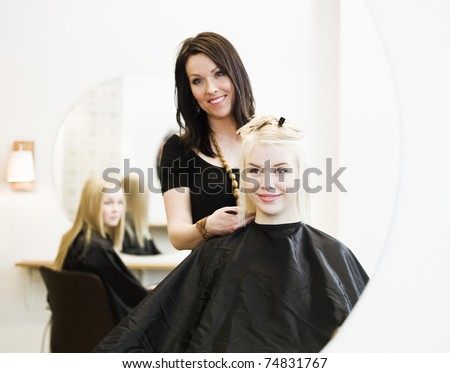 Young Girl at the Hair Salon - stock photo