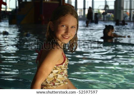 Young Girl at the Pool - stock photo