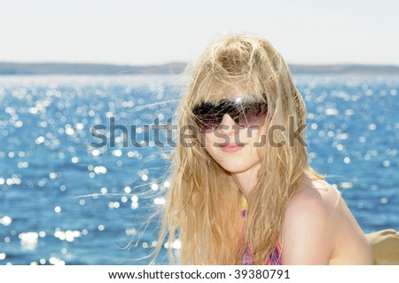 Young Girl at the sea - stock photo