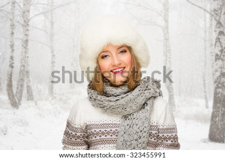 Young girl at winter forest - stock photo
